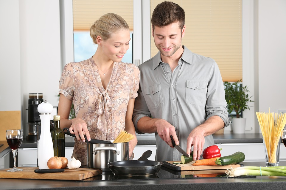 Couple cooking in a clean and tidy kitchen